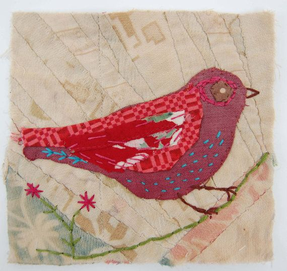Unframed appliqued bird with embroidery on to vintage crazy quilt scrap.