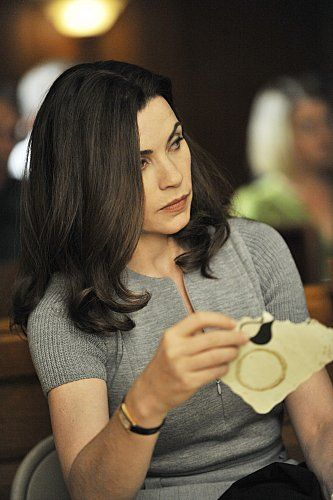 Still of Julianna Margulies in The Good Wife (2009). Like the zippered fitted grey sweater.