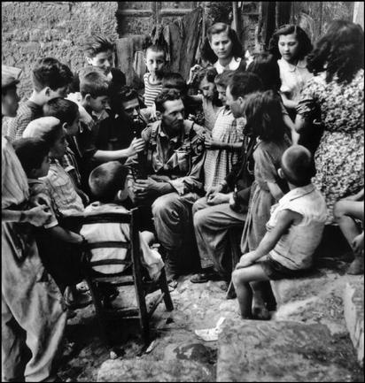 Sicily, 1943. Looks like that soldier is telling a good story!