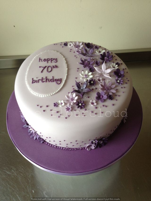 Delicate lilac, purple and white flowers on this 70th birthday cake.