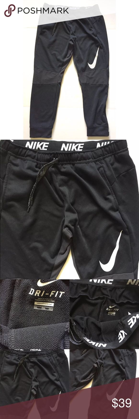 NIKE Black Dri Fit Ko Slacker Jogger Pants These Nike men's athletic pants are size XXL. These pants are black with a large white Nike swoosh. They are a jogger style where they are bigger in the thigh area and tighter and the calves. 