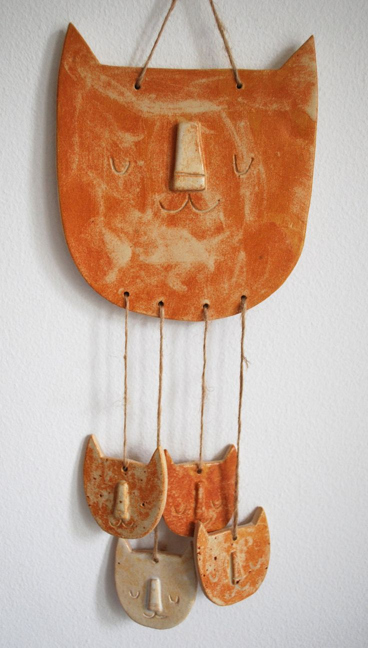 Ceramic sleeping cat and kittens wall hanging mobile. via Etsy.