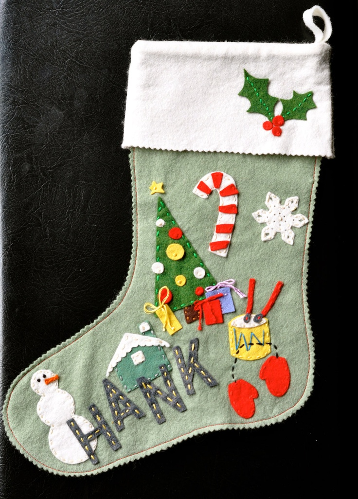 Love this whimsical vintage-style felt stocking by pretty swank. The best part, other than the fine detailing, is that it's actually shaped like a stocking!