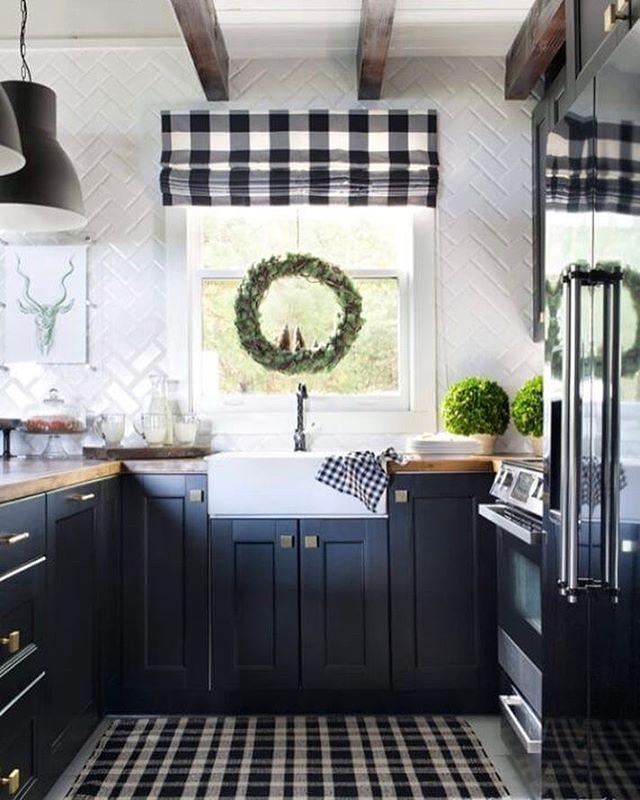 Black kitchen cabinets via Atlanta Home