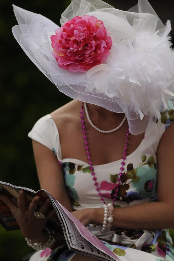 Hats of The Kentucky Derby / Oaks Fashion 2011  Love the entire look.  This is the essence of derby wear.  Dress sweet and demure, beautiful hat.  Pure elegance.  Only thing missing are white gloves with seed pearls.