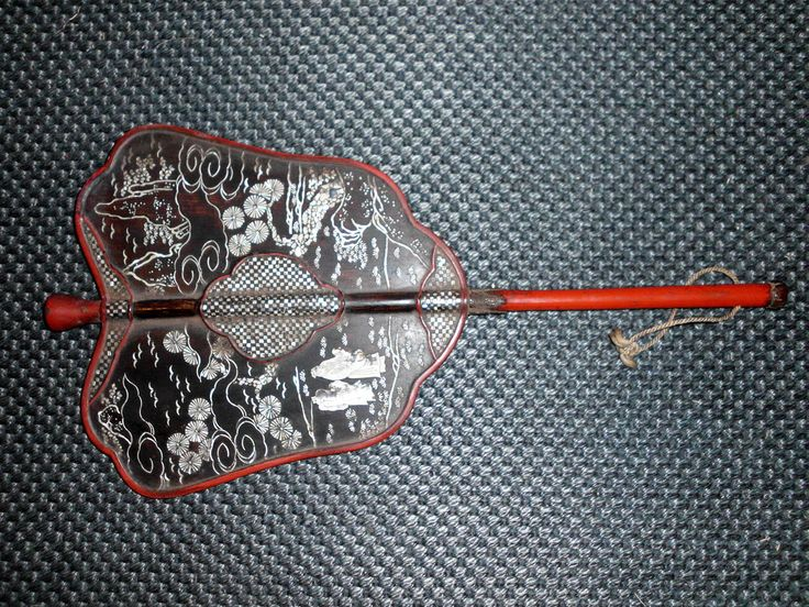 Antique Japanese samurai gunbai war fan. Wood and lacquer with shell inlay.