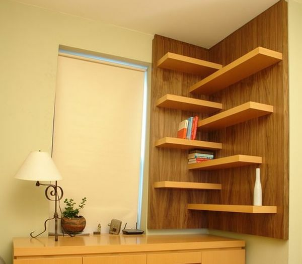15 cool books wall shelves placed in the corner of the room