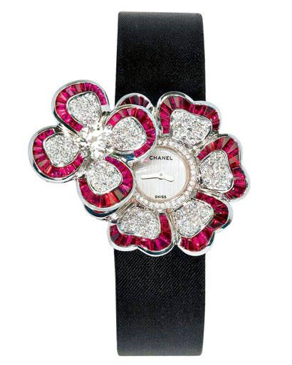 White gold, diamond, and ruby watch, Chanel watch, price upon request, call 800-550-0005  Read more: '50s-Inspired Fashion – Find the Best Fall Fashion and Accessories - ELLE  Follow us: @ElleMagazine on Twitter | ellemagazine on Facebook  Visit us at ELLE.com