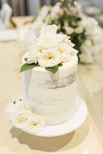 Bells Orange naked cake decorated with white roses and camelias #naked #wedding #cake #bellscake #bellsdolci #celebrationcake