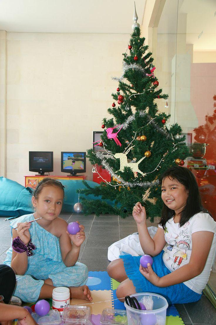 Decorating Christmas tree activity at Prego Family Brunch - Santa and His Elves #pregobali #westinbali