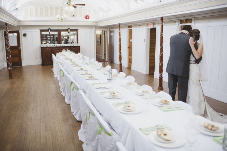 High Tea style seating for intimate groups of 50 or fewer. Dining hall decorated for wedding reception. The SS Sicamous is a premier wedding venue in the beautiful Okanagan. Get married on the beach or at the bow of the ship! Photo taken by Lorena from Lorena Astrid Photography