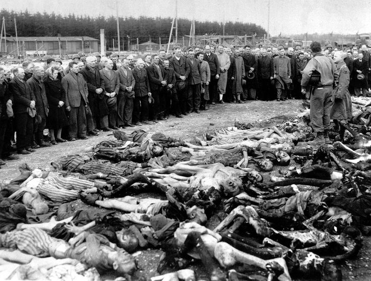 Lt. Col. Ed Seiller of Louisville, Kentucky, stands amid a pile of Holocaust victims as he speaks to 200 German civilians who were forced to see the grim conditions at the Landsberg concentration camp, on May 15, 1945.