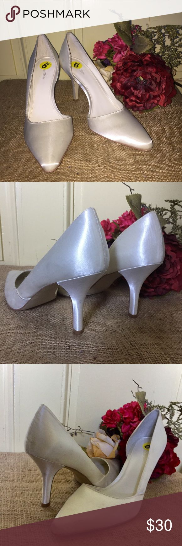 """NWT Calvin Klein bridal white satin heels. SIZE 9 NWT Calvin Klein bridal white satin heels. SIZE 9. 3.5"""" heel. Elegant pointed toe style and crazy comfortable.  Never worn, but a few slight scuffs from being in storage. Smoke Free Home. Calvin Klein Shoes Heels"""