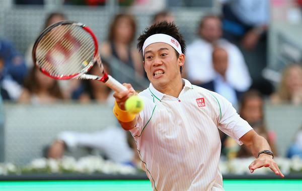 Kei Nishikori of Japan plays a forehand against Rafael Nadal of Spain in their final match during day nine of the Mutua Madrid Open tennis tournament at the Caja Magica on May 11, 2014 in Madrid, Spain.