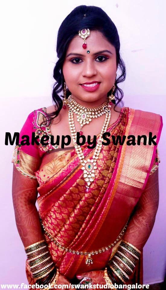 Traditional Southern Indian bride wearing bridal silk saree and jewellery. Reception look. Makeup and hairstyle by Swank Studio. #BridalSareeBlouse #SariBlouseDesign #kundanjewellery #bangles #curls Silk kanchipuram sari. Tamil bride. Telugu bride. Kannada bride. Hindu bride. Malayalee bride  Find us at https://www.facebook.com/SwankStudioBangalore
