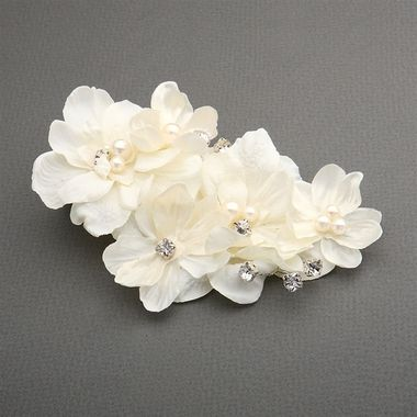 This elegant floral headpiece is a wedding hair clip featuring a 8.5 cm wide and 13.5 cm tall cluster of low-rise ivory silk flowers, pearls & crystal accents.  This sophisticated bridal or headpiece on a spring clip is handmade.
