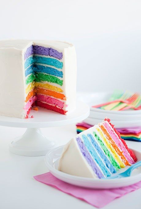 A humble buttercream-frosted cake that reveals brightly colored layers once you slice into it is a must. Click here to see more rainbow wedding cakes. Cake by One Charming Party