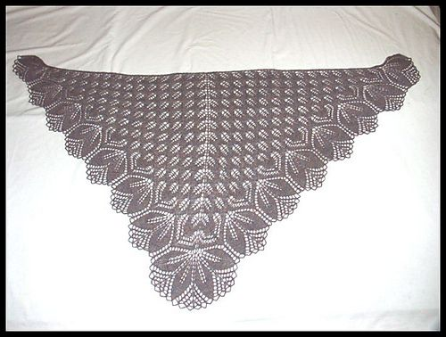 "Finished size: 60"" wide x 31"" high.  4 days to knit.  Love the edging!  Very nicely written pattern; both charted and written directions included; stitch counts for every row.  140 rows."