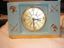 HOWELL vintage desk mantel clock. Westinghouse teal ceramic Knight theme