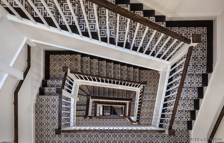 Patterned carpet on central staircase in period property in Sloane Street.