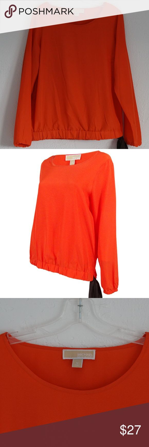 Michael Kors Women's Long Sleeve Tie Hem Top Orange Long-sleeve top boasts a surprise finish in the form of a contrasting chiffon tie at the hem in the color black.   MEASUREMENTS Length: 24 1/2 inches Hem: 18 inches Arm Length: 24 inches Pit-to-Pit: 20 inches  SHIPS WITHIN 24 HOURS Priced too high? Make an offer. Create a bundle and save some $$$. A11 Michael Kors Tops Blouses