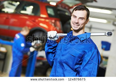 Young repairman auto mechanic inspecting car during automobile maintenance at engine auto repair shop service station by Dmitry Kalinovsky, ...