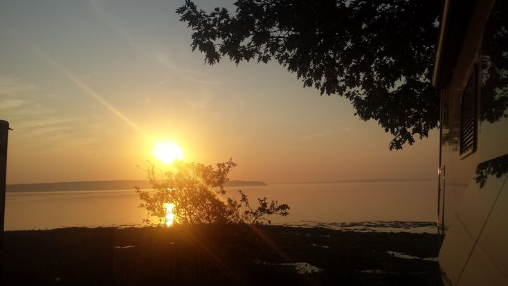 Sunrise at Searsport, Maine located on Penobscot Bay. Our RV campsite at Searsport Ocean campground was situated overlooking the bay. #penobscot-bat #rv-travel #Maine #small-towns #harbors #sabbatical #beachnana.com