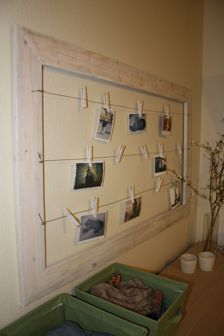 I love my photo frame : )   4$ worth of fence boards, some white stain, picture wire, and tack nails