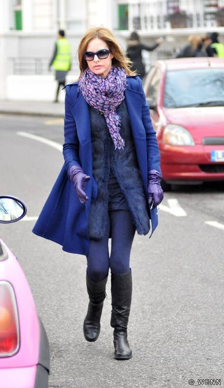 Trinny Woodall looking stylish, if a touch over-padded. Eat some chips love!