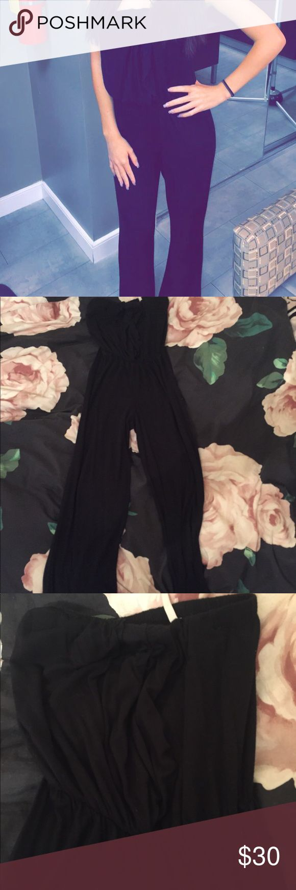Black Strapless Jumpsuit Black strapless jumpsuit. A bit of a stretchy comfy material. Wider leg. Size XS. Great condition. I'm 5'0 and it went to about the floor on me Dresses