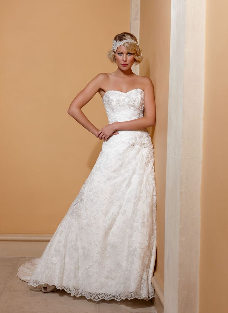 http://www.philcollinsbridal.co.uk/collections/phil-collins-bridal/2012/pc1366/full