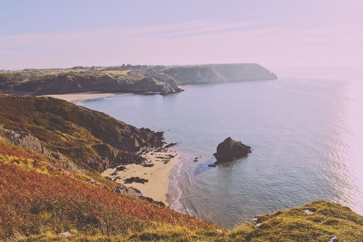 Overlooking Three cliffs bay, Gower, South Wales.