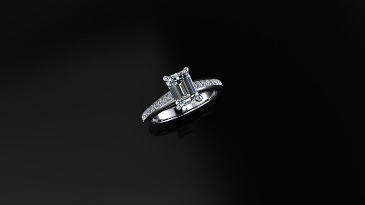 Beautiful emerald cut ring with accent stones