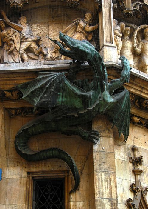 Dragon on the Neues Rathaus, München/New Town Hall, Munich, Germany; this part of the building is called the Wurmeck ('Dragon/Worm Corner'); the dragon association may be due to a fabled plague-causing lindworm killed there or to the heraldic arms of the Schönecker family, who once had a house on the site. (Photo by Martin Parr, via fmfy)