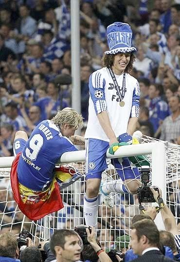 Leg up: Fernando Torres and David Luiz, too, were determined to enjoy themselves  Picture: AP