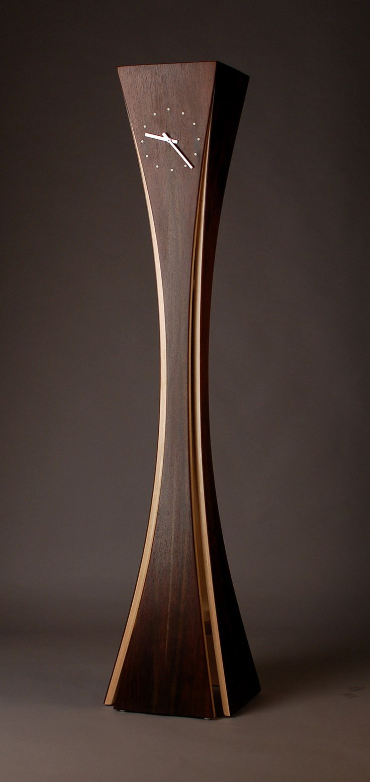 """""""Vega Clock"""" created by Kyle Dallman Black walnut and aspen wood are used in a bent lamination technique. The legs are then mitered together at the top."""