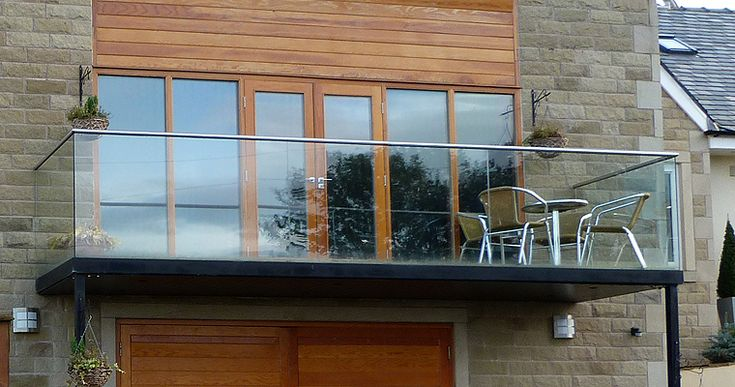 Steel & frameless glass balustrade in Whalley - Carter Fabrications
