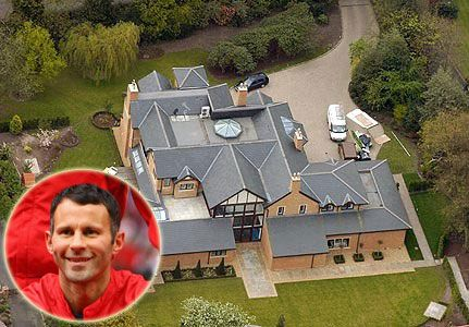 Manchester United player Ryan Giggs paid £1900000 in 2004 for a Victorian mansion in Worsley, near Manchester, only to knock it down and build this enormous lego block-style home in its place.  Giggs' new six-bedroom property consists of a glass tower, indoor swimming pool, private gym, and sauna and steam room.