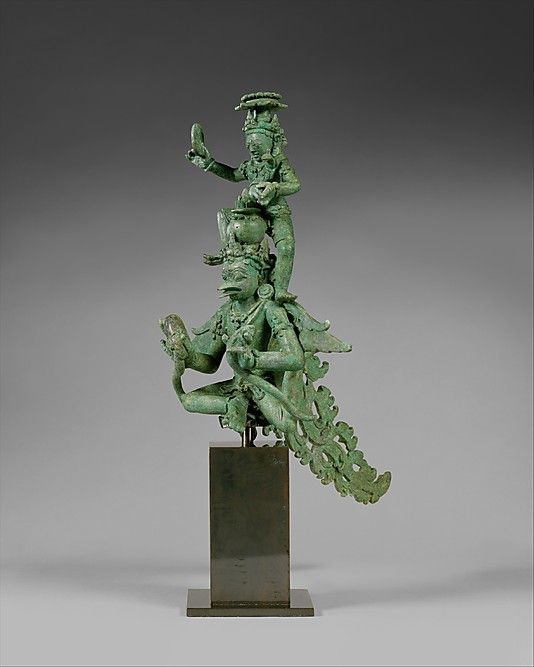 A ninth-century bronze Javanese figure of Krishna on Garuda; Garuda, half-man and half-bird, symbolises the power of the sun and slays evil serpants; he carries a jar containing the elixir of immortality on his head. (Metropolitan Museum of Art)