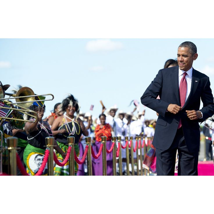 US President Barack Obama dances to music upon arrival on Air Force One at Julius Nyerere International Airport in Dar Es Salaam, Tanzania, on July 1, 2013. AFP PHOTO / Saul LOEB (Photo credit should read SAUL LOEB/AFP/Getty Images)