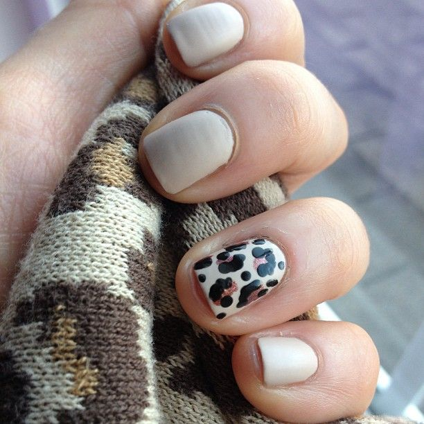 """Animal print accent nail with nude polish. If you can't paint the accent nail go to EBAY & type in """"nail stickers"""". There are hundreds of decals for 99 cent per set with free shipping. For a leopard print decal follow link below: http://www.ebay.com/itm/US-SHIP-1PCS-in-White-Base-Leopard-Print-Design-For-Nail-Art-Foil-Stickers-New-/251340355124?pt=US_Nail_Care&hash=item3a850d7634"""