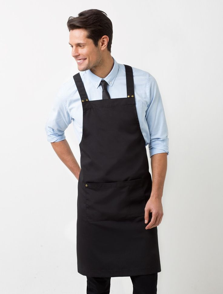 The Deluxe Canvas Bib Apron in Black is an industry favourite that is stylish, functional and sophisticated. With subtle detail in all the right places, the Deluxe Canvas Bib is the perfect staff uniform item that can be dressed-up with a tailored shirt or worn with a casual tee. This designer apron is made from durable poly/cotton canvas, with cross-back straps, spacious front pocket and features metal hardware. Also available in White and Navy, and as a waist apron. Please refer to the…