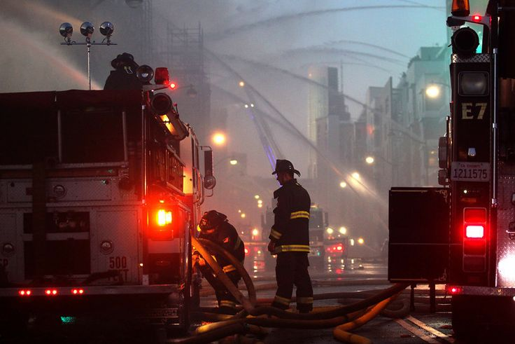 San Francisco firefighters battle a 6-alarm fire on an apartment complex under construction at Fourth Street near China Basin in San Francis...