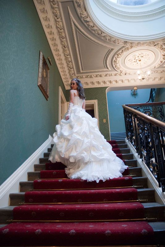 Addington Palace - Wedding Venue in Surrey The bride on the stairs at Addington Palace