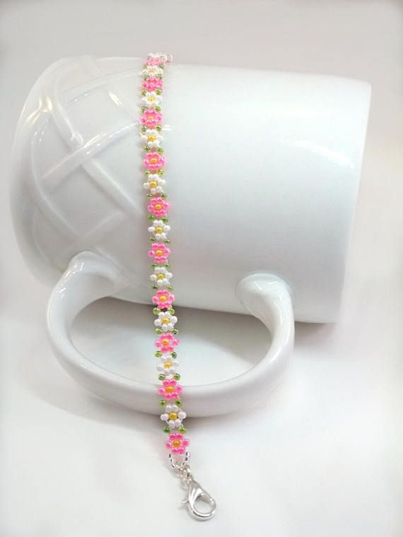 MADE TO ORDER I will handcraft this bracelet using premium quality light-weight Glass Seed Beads to create Bright Pink and White Flowers. This bracelet has been double threaded for extra strength using 8lb Fireline (a very durable nylon thread). When finished this bracelet has a 1