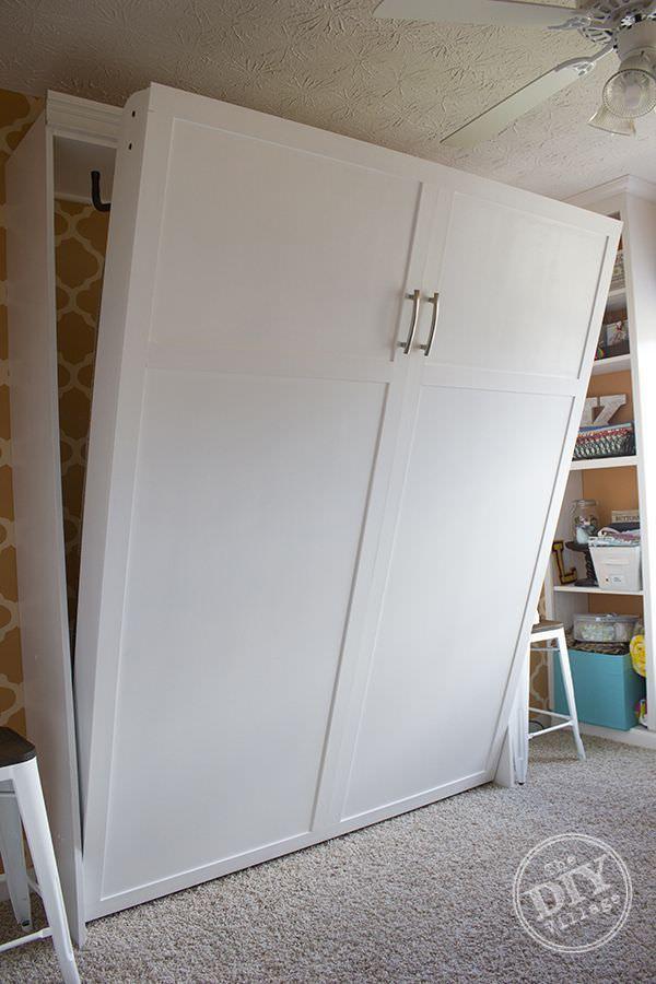 Concealed, fold-down bed behind false BIC