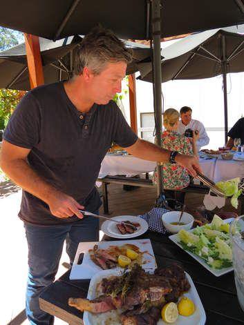 Chef John Torode prepares barbecued beef with salad.