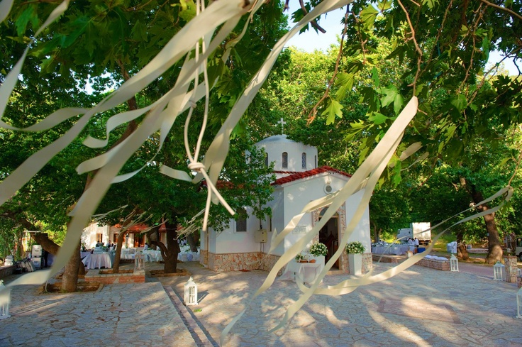 Beautiful Church of Agios Anastasios in Greece between huge plan trees !!