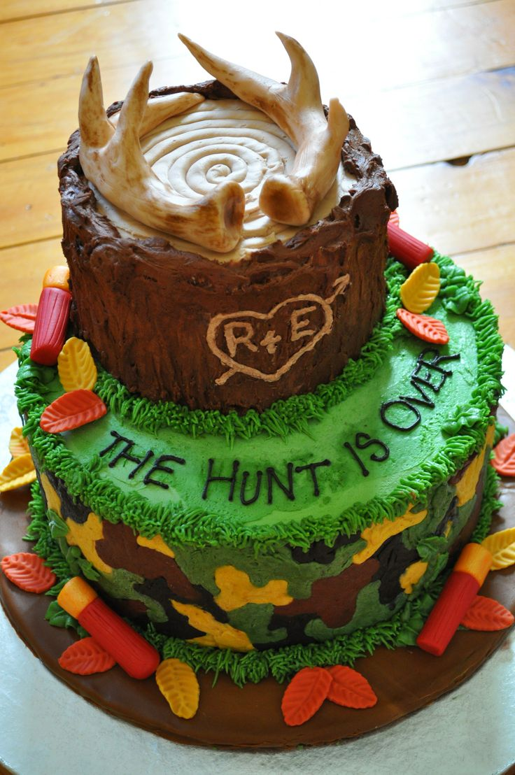 Hunting Groom's Cake - Vanilla cake with chocolate buttercream frosting. Decorated with buttercream frosting and fondant accessories.