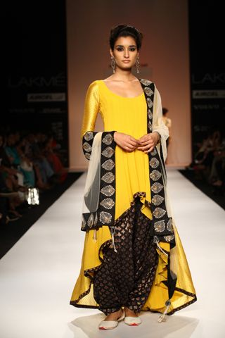 Yellow georgette and woven silk high-low kurta worn with black banarsi silk Patiala salwar and ecru tulle dupatta with black silk embroidered border. SHOP THE LOOK: http://www.payalsinghal.com/off-the-runway/noor-suit
